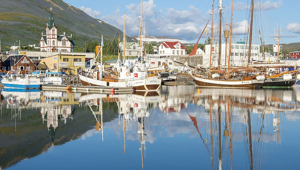 A fishing boat anchored in Husavik harbour. Photo: Albertoloyo | Dreamstime
