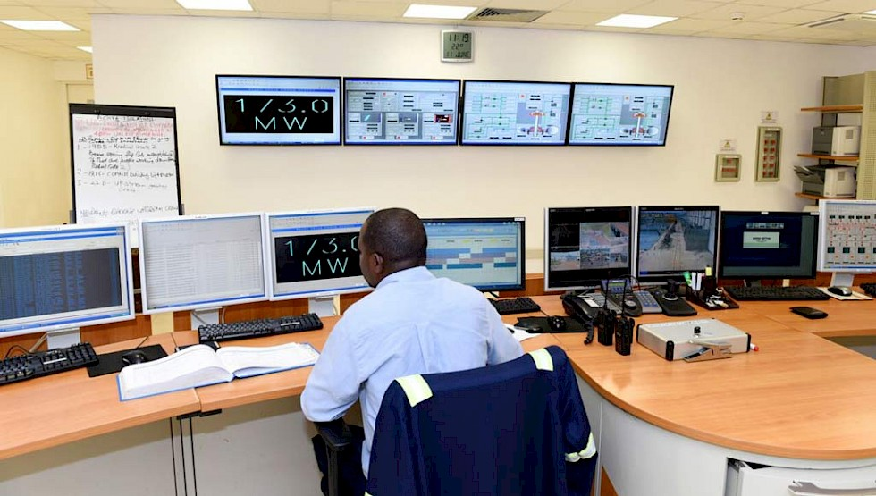 A worker in the control room at Bujagali hydroelectric power station.